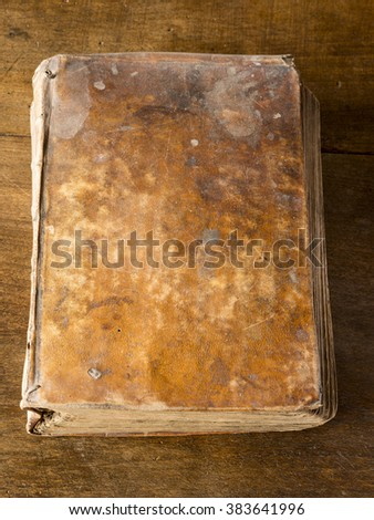 Closed old book on wooden table