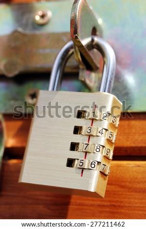 closed padlock on a wooden door - stock photo