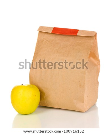 Closed paper bag with food isolated on white - stock photo