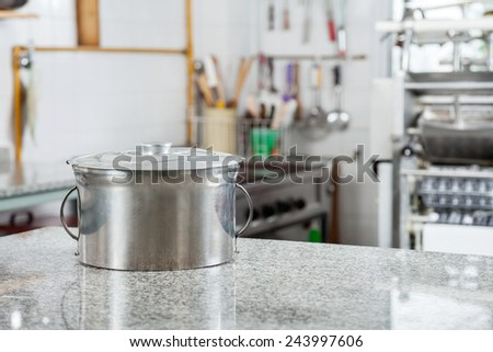 Closed pasta pot on marble countertop in commercial kitchen - stock photo