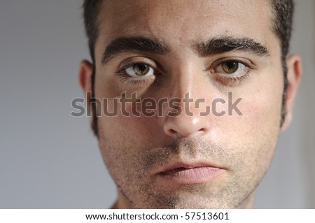 Closed portrait of a man with water drops - stock photo