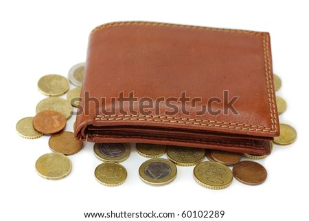 closed purse on a white background with scattered coins - stock photo