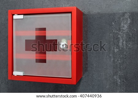 Closed Red Metal Empty Medicine Cabinet Hanging On A Dark Gray Marble Wall  Background. Perspective
