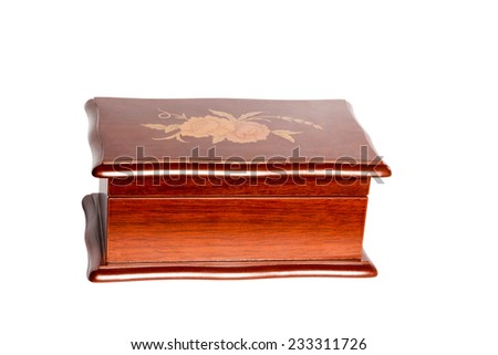 Closed retro wooden box casket with an ornament on the cover isolated on white background - stock photo