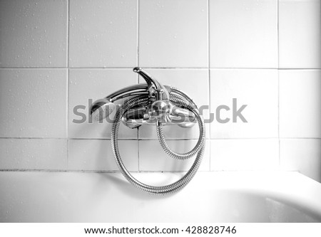 Closed shower tap in the bathroom - stock photo