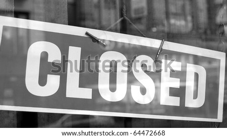 Closed sign in a shop showroom with reflections - (16:9 black and white) - stock photo