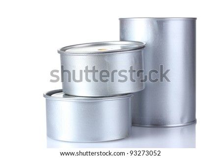 closed tin cans with paint isolated on white - stock photo