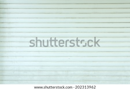 closed untidy roller blinds - stock photo