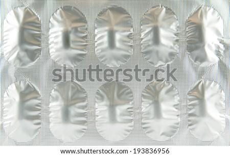 Closed up Aluminum foil blister strip show medicine concept - stock photo