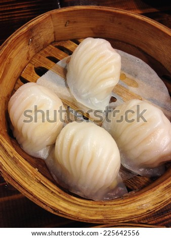 closed up dimsum fill with shrimp in bamboo basket - stock photo