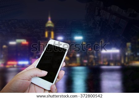 Closed up hand of man touch screen, Night view background - stock photo