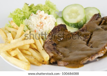 Closed up of lamb chop poured with black pepper sauce.