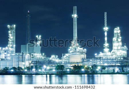 Closed up Oil refinery factory with reflection on the river. - stock photo