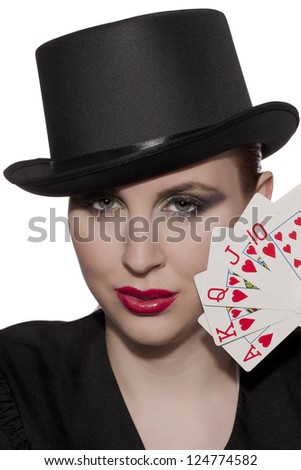 Closed up portrait of a woman in black hat holding cards
