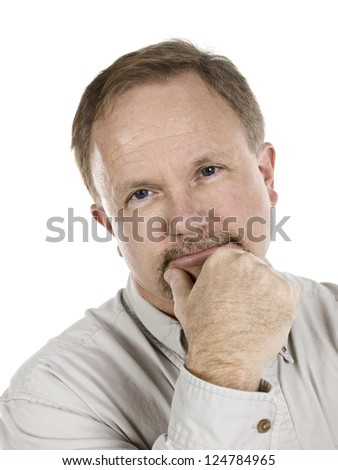 Closed up portrait of an attractive old man holding his chin over a white background
