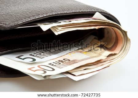 Closed wallet full of banknotes