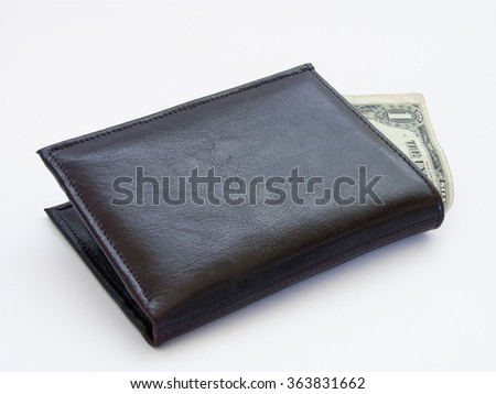 Closed wallet with sticking one dollar - stock photo
