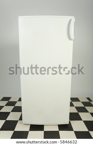 Closed white fridge. Front view - stock photo