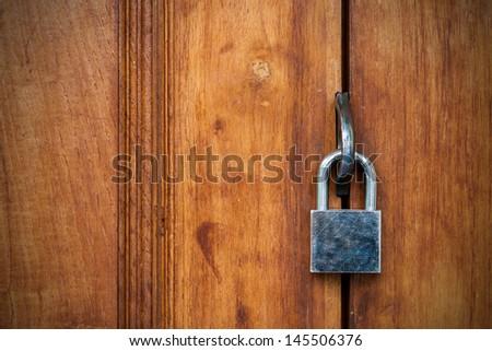 Closed wood lock door security - stock photo