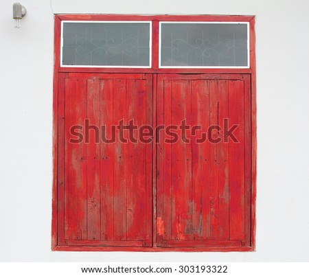 closed wooden windows on rural house