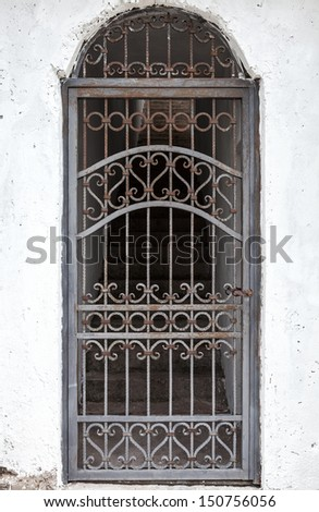 closed wrought iron railing on doorway with stairs - stock photo