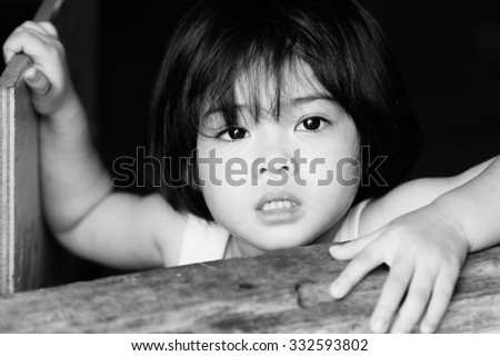 Closeup adorable face little asian girl have beautiful eyes after cry. - stock photo