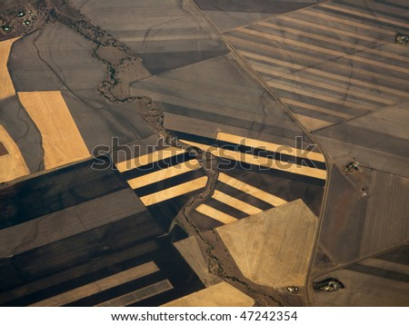 Closeup Aerial view of crop patterns of fields in Queensland Australia's Fertile Plains - stock photo
