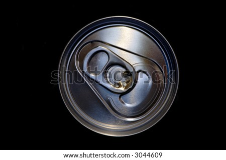 closeup aluminum drink can in black - stock photo