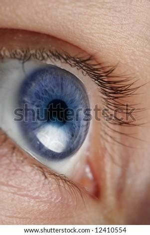 Closeup an eye - stock photo