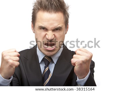 Closeup angry businessman holding his fists into camera. Isolated on white background
