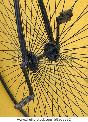 closeup antique high-wheel bike and pedals