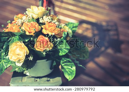 Closeup artificial bouquet decorated in front of old bicycle - stock photo