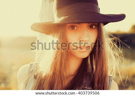 Closeup attractive beautiful woman with fluffy brunette long hairs,smiling, having fun on the park,wearing vintage ,outfit and hat,vacation style,autumn look,hairstyle,hairdresser, sad - stock photo