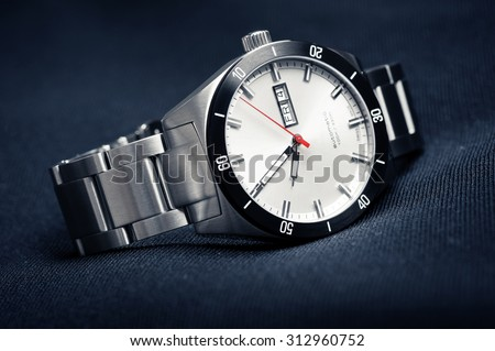 closeup automatic men watch with stainless steel wrist - stock photo