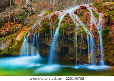 closeup autumn waterfall - stock photo