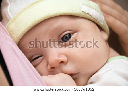 Closeup baby portrait with beautiful gray eyes.