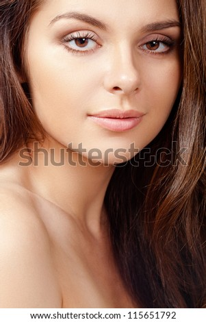 closeup beautiful brunette woman with clear skin portrait