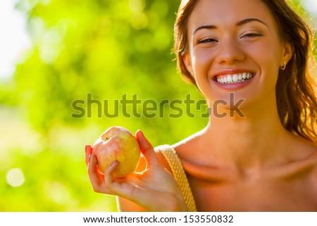 closeup beautiful girl portrait holding apple - stock photo