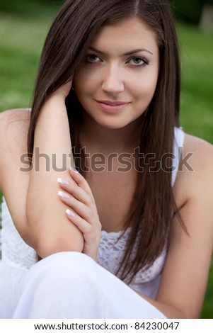 closeup beautiful woman face portrait outdoors - stock photo