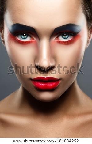 closeup beauty creative red and blue makeup woman face - stock photo