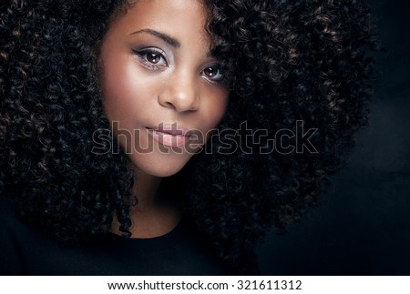 Closeup beauty portrait of young african american girl with afro and glamour makeup. - stock photo