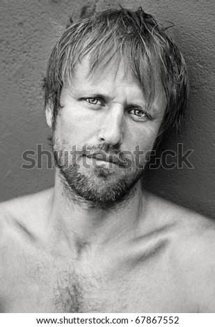 Closeup black and white portrait of a handsome young man. - stock photo