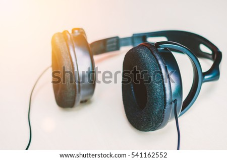 closeup black Headphone on white background with sunset