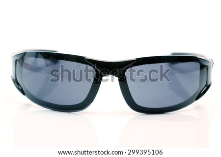 closeup black modern sun glasses isolated on white background - stock photo