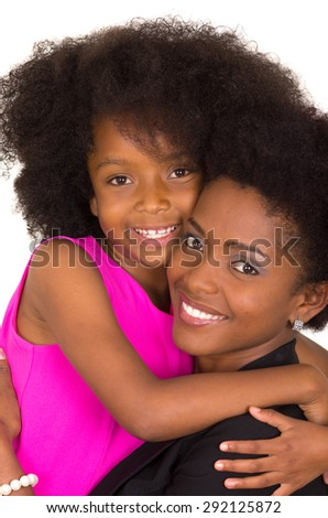 Closeup black mother daughter posing happily and hugging - stock photo