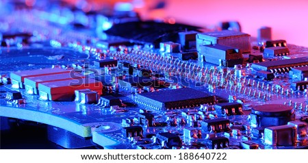 closeup blue microcontroller board with red and blue light - stock photo