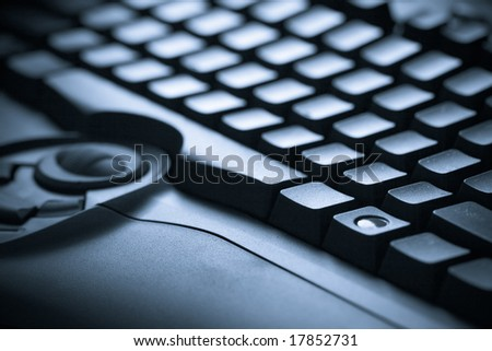 closeup blue toned keyboard photo background, technology concept