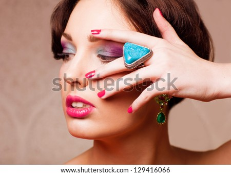closeup body part portrait of young beautiful woman in jewellery - stock photo