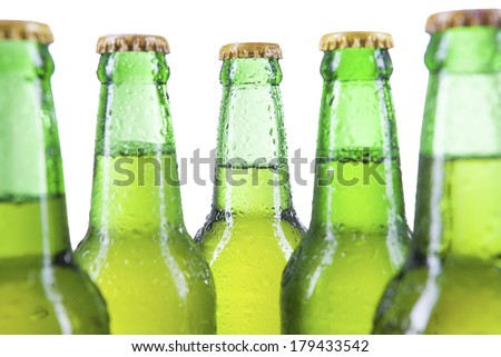 Closeup bottles of beer with drops isolated on white background - stock photo