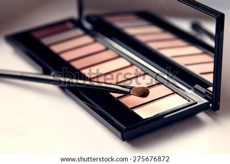 Closeup Brush with Eyeshadow Palette. Pink Nude Colors Eyeshadow. Professional make up.  - stock photo